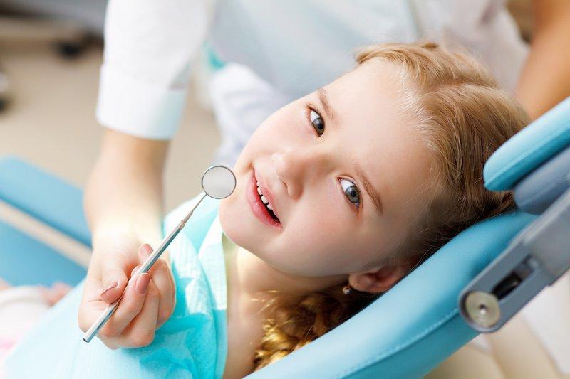 37280-bigstock-little-girl-visiting-dentist-35934937.jpg